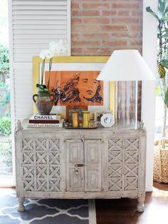 Kristen Nix Interiors - Antique Spanish chest, Ethan Allen glass cylinder lamp