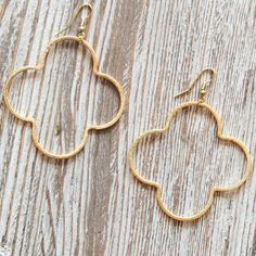 Lightweight + delicate, this pair of large gold clover earrings {$29.50} is our new favorite! #signaturepiece #gold #clover #madisonraleigh