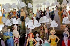 Guests found their seating assignment on their very own paper doll at this retro-themed wedding. Custom outfits waited at their corresponding table for some pre-party fun.Photo Credit: Trevor Booth on Snippet and Ink via Lover.ly