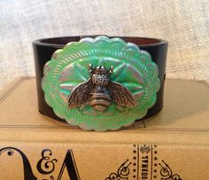 Leather cuff bracelet, handmade from recycled belt, silver toned bee on painted concho, black belt
