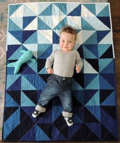 "I love ""floor quilts"" for babies. Modern Indigo Ombre Triangles Unisex Baby Quilt and Playmat Quilting Projects, Quilting Designs, Sewing Projects, Baby Quilt Patterns, Patchwork Patterns, Quilting Patterns, Baby Boy Quilts, Modern Baby Quilts, Half Square Triangle Quilts"
