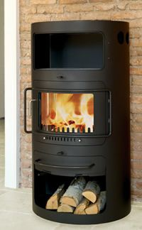 Hwam Classic 7 wood burning stove with an oven from www.WoodenSun.com . We sell #woodstoves by Vermont Castings, Regency, Pacific Energy, Blaze King & HWAM. #fireplaces #woodburningstoves