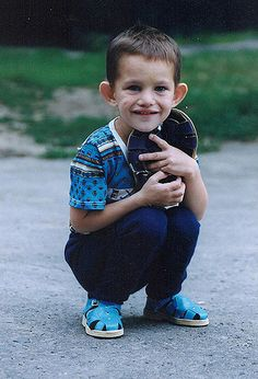 A Russian orphan receives a new pair of shoes