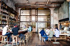 Drink: Smokestack. The already famous Magnolia Brewing Company recently opened a new place on Third Street. The space is huge with an industrial-rustic feel, hop scent lingering in the air, communal tables for larger groups, choice BBQ, and a stunning bar that offers some cocktails and strong spirits. Third Street between 22nd & 23rd