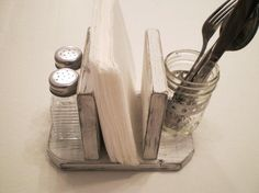 Like this idea. Need something to keep the napkins, salt/pepper and maybe drinking straws (we use a lot of them) on the table