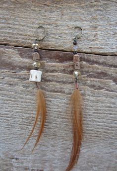 Scorpion Sisters peach feather and wood earrings available as part of our mothers day special:  http://www.etsy.com/listing/98300037/sale-peach-feather-and-wood-earrings