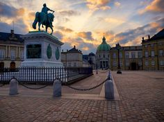 A stunning sunset over Amalienborg Palace and The Marble Church