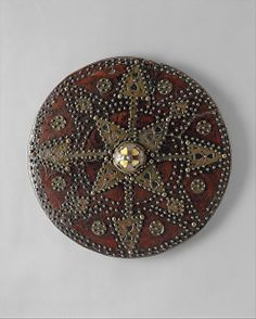 Highland Targe  Date:     1700–1750 Culture:     Scottish Medium:     Wood, leather, brass, horn, textile Dimensions:     Diameter, 19 3/4 in. (50.17 cm) Classification:     Shields