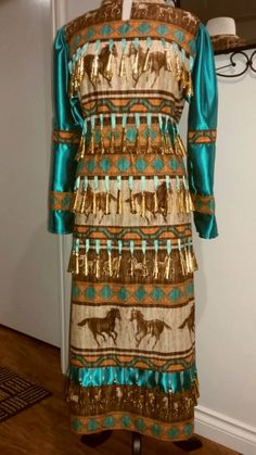 Clearance!! Brand new made by me Maria Perry Regalia. I cannot capture the true colour in my pics. It is brown tones and lovely teal blue. Ladies jingle dress size 8/10 (for proper fit) rangle...BUT please go by the actual measurements listed: 162 gold tone jingles. Shoulders 16