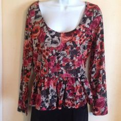 Floral Peplum Cute floral peplum with scoop neck and long sleeves. Tops