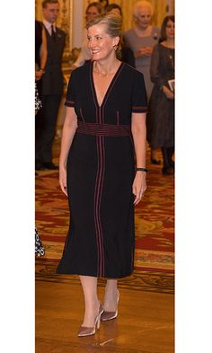 Co-hosting the Commonwealth Fashion Exchange Reception at Buckingham Palace with Duchess Kate was Sophie Wessex, who wore a black Burberry dress with red piping.