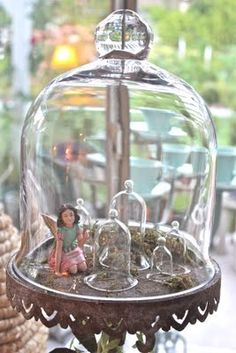 Cloche filed with mini cloches....and fairy.  Thank you to pinner Jayne Perry for her wonderful board of cloche decor.