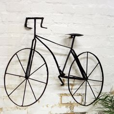 "Sometimes something off-the-wall looks great on the wall. The ""Scrap Metal Wall Bicycle"", $98.00"