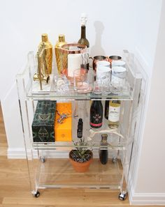 Kathy Kuo Bar Cart Accessorizing your bar cart is just as important as accessorizing your look. Especially in small spaces, a bar cart becomes the center of entertaining and can make all the difference to being the hostess with the mostest. Mixing metals in this case is totally acceptable – and while this is the …