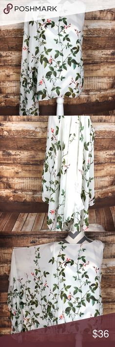 """Adrianna Papell White Floral Top Size 16 Plus Size Stunning Adrianna Papell cold should floral shirt! Simply beautiful! White background with pink and green flower / leafs throughout. Has cami underneath so it isn't sheer. Sleeveless on one side. Other side has sleeve with gold bead accent. At the top of the same side is a another gold bead accent. This shirt has been worn 1 time and is in excellent condition. No flaws! Size 16. Measures 23"""" from pit to pit. Measures 25"""" long from top of…"""