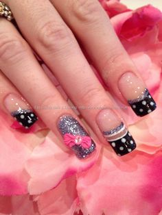 Black polka dot freehand nail art with charcoal glitter and pink 3D acrylic bow nail art and Swarovski crystals
