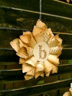 DIY instructions on how to make these whimsical paper stars, as ornaments or as gift tags for presents out of old book pages.
