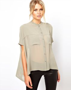 blouse with sheer panels and double pockets