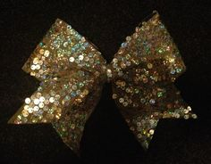 Gold Sequin Cheer Bow that I made- $12.50  https://www.etsy.com/listing/157962266/gold-sequin-cheer-bow