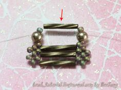 5. Add one seed bead, one pearl and one seed bead to each thread. Cross both threads at the bugle bead (red arrow).