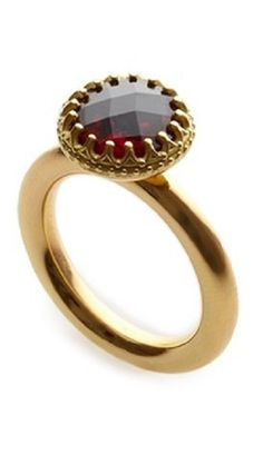 Marianne Anderson ,18ct gold ring with 9mm chess-cut garnet in an ornate stone setting