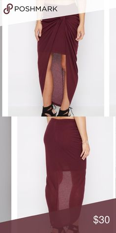Plum high low maxi skirt 😍 Plum knotted maxi skirt with ribbed knit texture. Built in lining 100% polyester. Skirt 65% polyesters, 35% rayon. No holds. Skirts Maxi