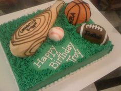 Sports Cake - Baseball bat, football, and basketball are all cake covered with buttercream.   The baseball is fondant. The cake is buttercream.