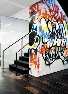 graffiti wall. we could make this happen tomorrow and it'd look really good with the plocks and whatnot - just sayin'.