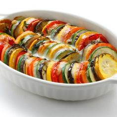 From juicy tomatoes to tender summer squash, this eye-catching ratatouille is filled with layers upon layers of colorful Kinds Of Vegetables, Colorful Vegetables, Veggies, Baked Ratatouille Recipe, Vegetable Slice, Classic French Dishes, Curry, Food Backgrounds, Oven Roast