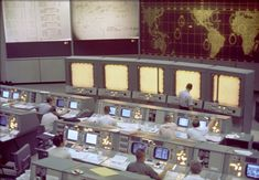 Overall view of the Mission Control Center (MCC), Houston, Texas, during the Gemini 5 flight. Note the screen at the front of the MCC which is used to track the progress of the Gemini spacecraft. Where To Find Jobs, Project Gemini, Johnson Space Center, Mission Control, Nasa Missions, Space Race, Space Program, Space Exploration, Houston