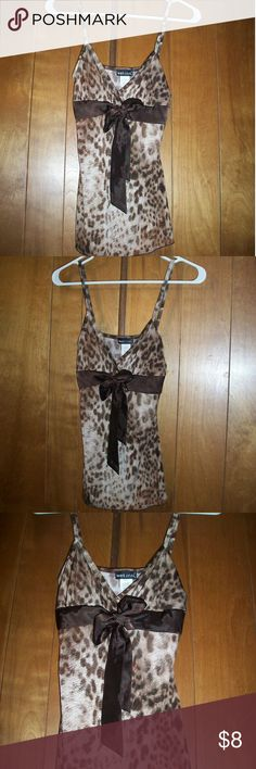Sexy Cheetah Bow Top Sexy Cheetah Bow Tank Top -soft, silky & stretchy!  -92% Polyester/ 8% Spandex -gently used Wet Seal Tops Tank Tops