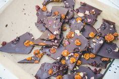 Maca chocolate bark with dried cherries, dried golden berries, and dried rose petals.