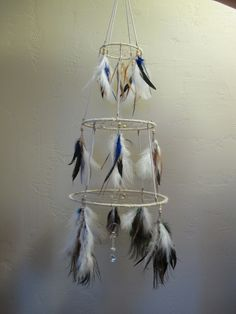 dreamcatcher mobile handcrafted with love, this dream catcher chandelier mobile is adorned with custom feathers, beads & stones to suit your nursery color theme. Special orders upon request for your nursery color scheme, please allow 2-3 weeks production for orders, just message me your custom request! ...