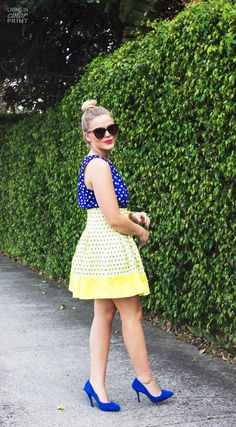 Cobalt + Yellow. I love the colors and skirt and blouse combination. The skirt is a little too high.  I don't care for the glasses too much.