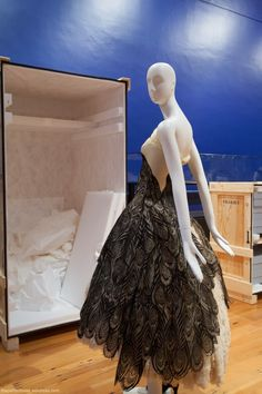 The Alexander McQueen Peacock dress was made from 22 individual panels of specially commissioned lace. Each panel was individually trimmed, draped, and attached by hand, onto the base structure of the dress.  The dress itself consists of the wispiest silk gauze draped over a bustle and pannier understructure supported by the most ethereal clouds of ruffled nylon mesh.