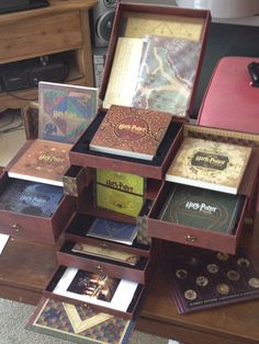 Harry Potter Wizard's Collection. All eight movies on Blu-Ray AND DVD PLUS: Catalogue of Artifacts, cloth map of Hogwarts, blueprint poster of Hogwarts, Horcrux locket, Utraviolet Digital Copy codes, Label collection (potions, memory vials, Honeydukes, and Weasley's Wizard Wheezes), and three bonus discs!