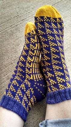 "Start date: March 20, 2015 Completion date: Apr 17, 2015 Pattern: Team Spirit Socks Yarn: Hazel Knits Artisan Sock in ""Primrose"" and ""Midas"" Needles: HiyaHiya 3.0mm for cast on; HiyaHiya 2.75mm for cuff; and HiyaHiya 2.5mm for rest of sock Notes: Did half the leg chart for shorter leg --- hollyisaac (Ravelry Name) said."
