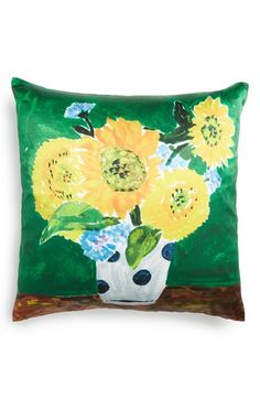bold and playful the kate spade new york sunflower vase throw pillow features a white polka dot vase filled with bold yellow sunflowers on a greenu2026