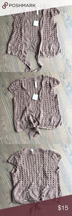 Liz Claiborne Crochet Tie Front Cardigan NWT, beautifully crocheted short sleeve, tie front cardigan.wear it tied or untied, throw it on over a white tee or tank and wear with cut off denim shorts for a cute boho look. Liz Claiborne Sweaters Cardigans
