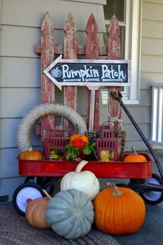 Repurpose a little red wagon to create a cute fall-ready display. Pack it with tons of pumpkins, gourds, and antique finds.