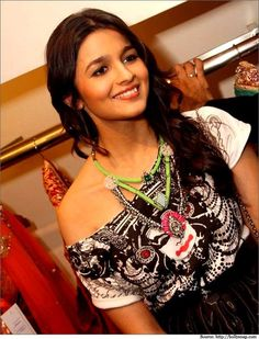 Alia Bhatt in a multi color stone studded matinee necklace.