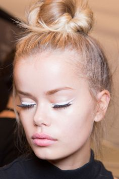 Top Knot and winged eyeliner makes this look worthy of a beauty crush.
