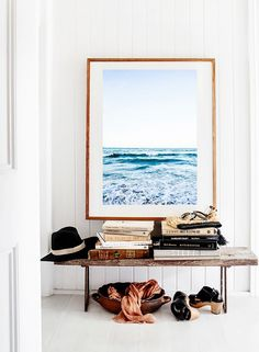 Entryway with a double-purpose bench and large art