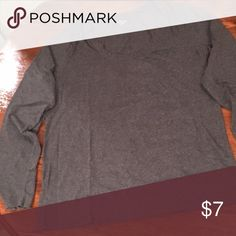 """⭐️NEW LISTING⭐️ Gray long sleeved tee ⭐️NEW LISTING⭐️ Gray long sleeved tee. Cotton and spandex gives this great basic scoop neck tee a little stretch to make a great fit. Length from shoulder to hem is 26"""". Underarm to underarm is 20"""". Sleeve length is 24"""". Tops"""
