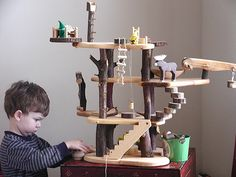 tree house dollhouse. Love the branches incorporated to the structural design. And the lookout post on top...that would be adorable for the calico critters