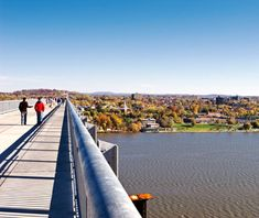 """Walkway over the Hudson (Poughkeepsie, NY). """"It feels like you're walking in the sky. This former railroad bridge is suspended 220 feet above a wide, unusually straight stretch of the Hudson that Dutch seafarers once called """"Lange Rack"""" or Long Reach. That means you can see up and down the river for miles—without any overhead structure to obscure the view."""""""