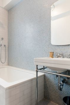Penny tile and subway tile combo done right. Design by Celeste Umpierre.