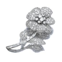 DIAMOND BROOCH, MONTURE VAN CLEEF & ARPELS, 1950S. Designed as a single flower, set with circular- and single-cut diamonds, mounted in platinum, signed monture V.C.A. and numbered, French assay and maker's marks, case.