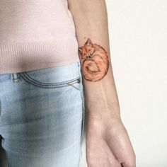 Fox tattoo on wrist by Olga Koroleva