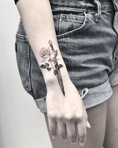 Get modern tattoos done right - that& what matters! - Fresh ideas for the interior, decoration and landscape - Subtle idea with rose and a knife tattoo - Sword And Rose Tattoo, Knife And Rose Tattoo, Knife Tattoo, Dagger Tattoo, Sternum Tattoo, Rose Tattoos, Body Art Tattoos, Small Tattoos, Sleeve Tattoos